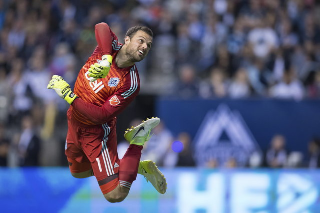 Vancouver Whitecaps goalkeeper Stefan Marinovic watches the ball after making a save against Real Salt Lake during the first half of an MLS soccer match Friday, April 27, 2018, in Vancouver, British Columbia. (Photo by Darry Dyck/The Canadian Press via AP Photo)
