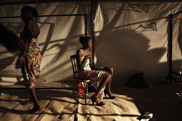 A Senegalese model sits backstage during Dakar Fashion Week in Senegal's capital, July 10, 2011. (Photo by Finbarr O'Reilly/Reuters)