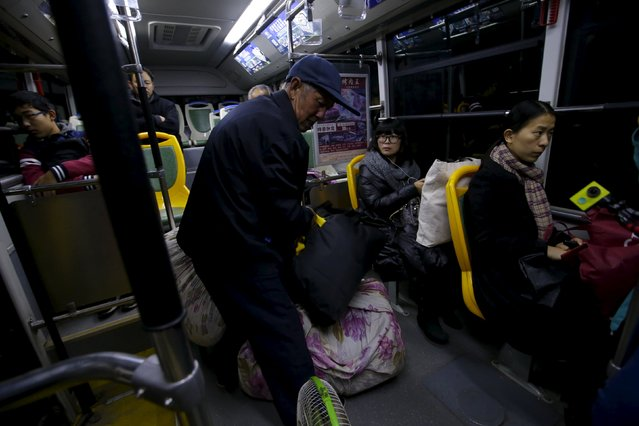 Li Nan (2nd R), a makeup artist, takes a bus on her way to Beijing for work from Tianjin, China, November 18, 2015. (Photo by Jason Lee/Reuters)