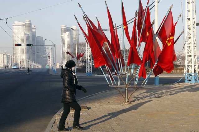 A person passes by a bouquet of Workers Party flags along a main street of the Central District in Pyongyang, North Korea, on Wednesday, January 6, 2021. (Photo by Jon Chol Jin/AP Photo)