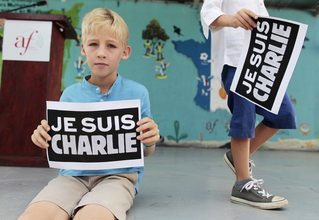 """A French boy residing in Nicaragua holds up a card that reads, """"I am Charlie"""", to pay tribute to the victims of the shootings in France at the offices of the satirical weekly newspaper Charlie Hebdo and a Jewish deli, in Managua January 10, 2015. (Photo by Oswaldo Rivas/Reuters)"""