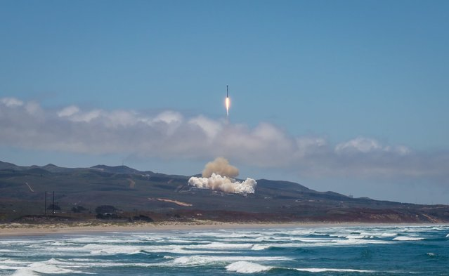 A handout photo made available by SpaceX shows a SpaceX Falcon 9 rocket lifting off with NASA's twin GRACE-FO satellites and five Iridium Next communications satellites from Vandenberg Air Force Base in California, USA, 22 May 2018. The ride-share GRACE-FO joint mission project with NASA and the German Research Center for Geosciences (GFZ) will track the movement of water across Earth. (Photo by SpaceX/EPA/EFE/Rex Features/Shutterstock)