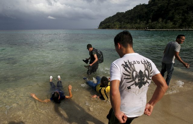 Cuban migrants rest by the sea after they crossed the border from Colombia through the jungle into La Miel, in the province of Guna Yala November 29, 2015. (Photo by Carlos Jasso/Reuters)