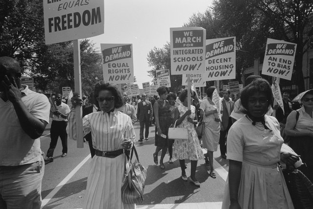 A procession carrying signs for equal rights, integrated schools, decent housing, and an end to bias during the civil rights march on Washington D.C., August 28, 1963. (Photo by Reuters/Library of Congress)