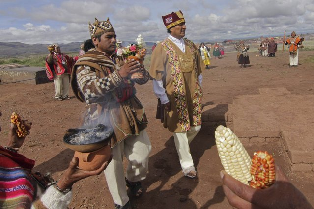Bolivia's President Evo Morales (R) wears ceremonial clothes as he participates in an Andean ceremony in Tiahuanaco, some 70 km from La Paz, in this January 21, 2015 handout photo provided by the Bolivian Presidency. (Photo by Reuters/ABI/Bolivian Presidency)