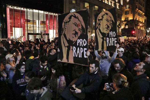 Protesters march along Fifth Avenue outside Trump Tower, Wednesday, November 9, 2016, in New York, in opposition of Donald Trump's presidential election victory. (Photo by Julie Jacobson/AP Photo)