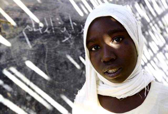 Kareema Abdallah Adam, a 4th grader at the Ardamata camp for the internally displaced poses for a photograph in El-Geneina in West Darfur, Sudan, November 24, 2015. Born in the camp, 12 years old Adam wishes to be a doctor in her adulthood. (Photo by Mohamed Nureldin Abdallah/Reuters)