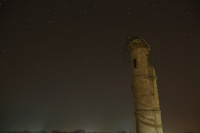 A damaged minaret is pictured at night in Aleppo, Syria December 11, 2015. (Photo by Ammar Abdullah/Reuters)