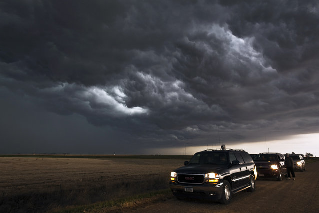 The storm chasers cars. (Photo by Camille Seaman/Caters News)