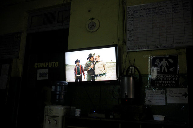 Rescuers watch TV as they wait during the night shift at the Comandos de Salvamento base in San Salvador, El Salvador July 17, 2016. (Photo by Jose Cabezas/Reuters)