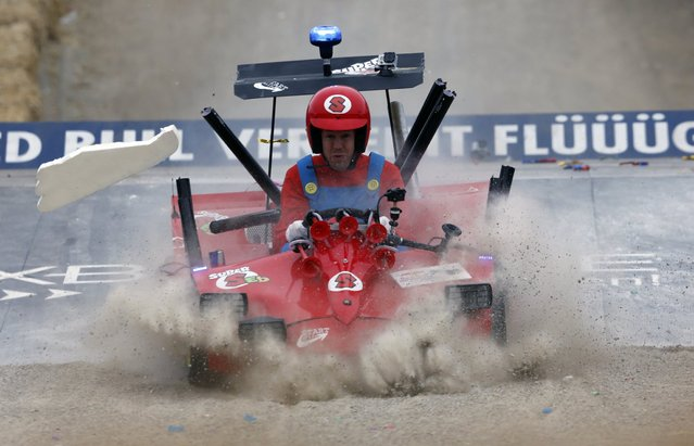 German three-time Red Bull Formula One world champion Sebastian Vettel loses a wing as he lands a jump during a soapbox fun race in the western German town of Herten, near Gelsenkirchen, July 14, 2013. (Photo by Wolfgang Rattay/Reuters)