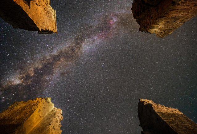 The Milky Way stretches across the night sky between four columns in the ancient Atashkooh Fire Temple near Mahllat city in Iran. (Photo by M. Ghadiri/Astronomy Photographer of the Year 2018)