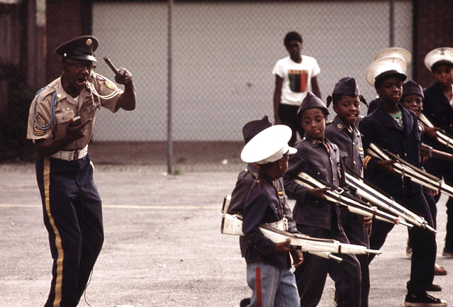 The Kadats of America, a young drill team, perform on a Sunday afternoon at a community talent show on the South Side. The leader, Major General Acklin, is shown giving commands to the youngsters, July 1973. (Photo by John H. White/NARA via The Atlantic)