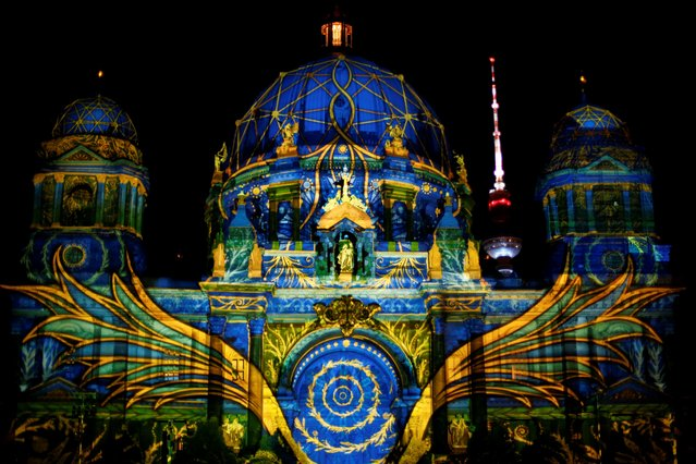 The Berlin Cathedral is illuminated during the Festival of Lights show in Berlin, Germany, September 11, 2020. (Photo by Joachim Herrmann/Reuters)