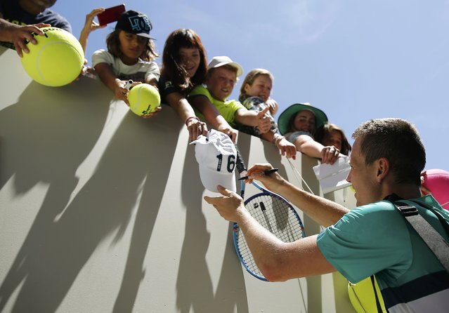 Czech Republic's Tomas Berdych signs autographs after winning his first round match against India's Yuki Bhambri at the Australian Open tennis tournament at Melbourne Park, Australia, January 18, 2016. (Photo by Thomas Peter/Reuters)