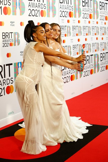 In a handout picture released by the Brit Awards, Leigh-Anne Pinnock, Jade Thirlwall and Perrie Edwards of Little Mix pose with their British Group award in the media room at the BRIT Awards 2021 in London on May 11, 2021. (Photo by John Marshall/Handout via Reuters)