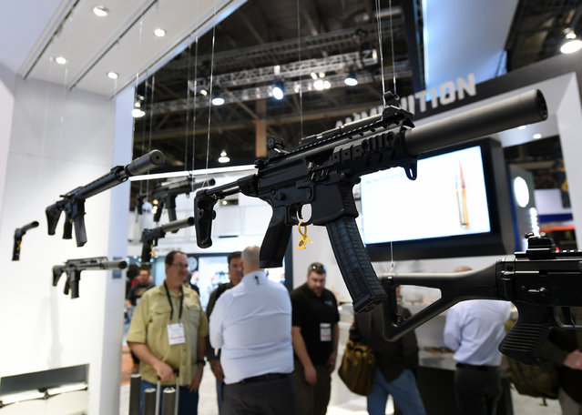 Firearms are displayed at the Sig Sauer booth at the 2016 National Shooting Sports Foundation's Shooting, Hunting, Outdoor Trade (SHOT) Show at the Sands Expo and Convention Center on January 19, 2016 in Las Vegas, Nevada. (Photo by Ethan Miller/Getty Images)