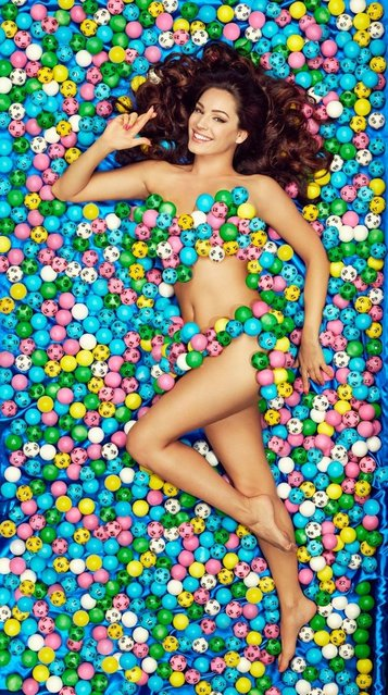 Kelly Brook lying on a bed of Lotto balls to celebrate today's special Lotto draw. The Lotto jackpot is a guaranteed £10 million prize with a further 1,000 raffle prizes of £20,000 up for grabs. (Photo by Camelot/PA Wire)