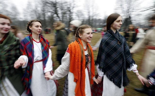 "Women dressed in Belarussian national clothes dance as they take part in a Slavic ""Spring welcome"" festival in the village of Viazynka, northwest of Minsk, March 21, 2015. (Photo by Vasily Fedosenko/Reuters)"