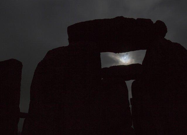 The solar eclipse is seen over Stonehenge on Salisbury Plain, Salisbury, southern England March 20, 2015. (Photo by Kieran Doherty/Reuters)