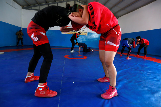 Iraqi women wrestle during practice at the sports club in Diwaniya, Iraq on November 10, 2018. The IWF has managed to recruit 70 female wrestlers who train at 15 clubs across the country, a spokesman for the body said. Each is entitled to a payment of 100,000 Iraqi dinars ($84) a month, but the money has stopped for the last three months as the IWF invests in a new wrestling hall in Baghdad. Despite the financial offer, recruitment is tough. (Photo by Alaa Al-Marjani/Reuters)