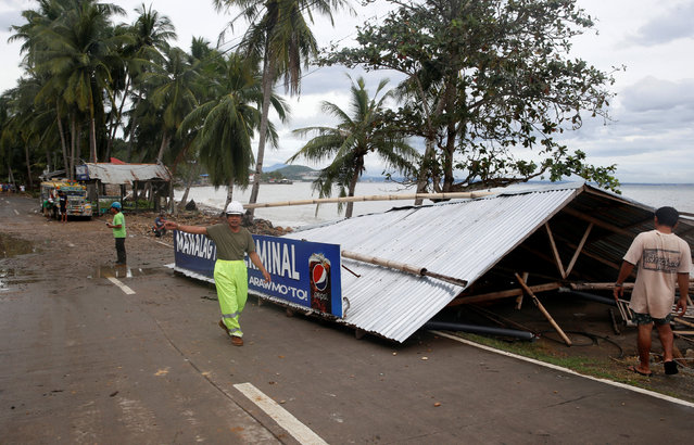 A passenger waiting shed is pictured after it was toppled by strong winds at the height of Typhoon Nock-Ten in Mabini, Batangas, in the Philippines December 26, 2016. (Photo by Erik De Castro/Reuters)