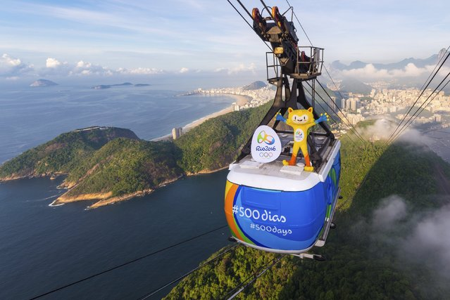 Rio 2016 Olympic mascot Vinicius is seen on the top of the Sugarloaf cable car, to mark 500 days to go until the Opening Ceremony of the 2016 Olympic Games in Rio de Janeiro, in this handout photograph released March 24, 2015. (Photo by Alex Ferro/Reuters/Rio 2016)