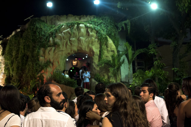 Clubgoers wait in line in front of Baby O nightclub on April 2, 2015 in Acapulco, Mexico. (Photo by Jonathan Levinson/The Washington Post)