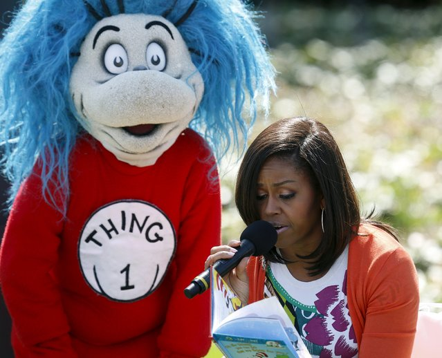 """U.S. first lady Michelle Obama reads """"Oh, the Things You Can Do That Are Good For You"""", a Tish Rabe adaptation of a Dr. Seuss book, to children visiting the White House during the annual Easter Egg Roll in Washington April 6, 2015. (Photo by Gary Cameron/Reuters)"""