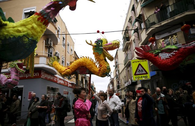 People attend a parade to celebrate the Chinese Lunar New Year, which welcomes the Year of the Monkey, in Madrid, Spain, February 13, 2016. (Photo by Andrea Comas/Reuters)