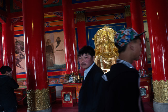Visitors at a temple dedicated to Genghis Khan in Ulan Hot. (Photo by Gilles Sabrie/The Washington Post)