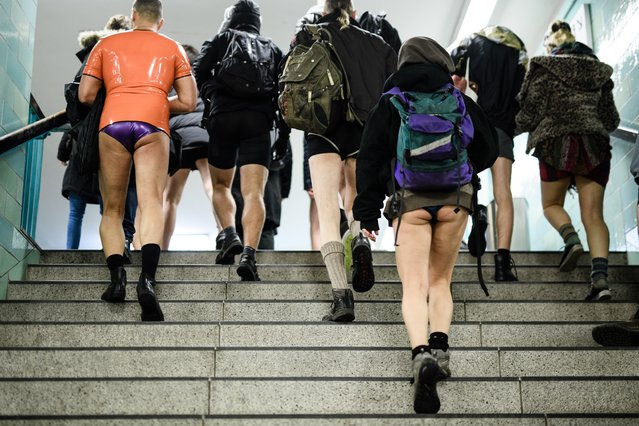 "People wearing no pants participate in the worldwide event ""No Pants Subway Ride"" in Berlin, Germany, January 13, 2019. (Photo by Clemens Bilan/EPA/EFE/Rex Features/Shutterstock)"