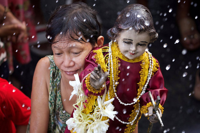 A devotee holds a figurine of the Santo Nino, also known as Holy Child Jesus, to be blessed with holy water during the annual feast day of Santo Nino in Tondo, Manila, Philippines, January 20, 2019. (Photo by Eloisa Lopez/Reuters)