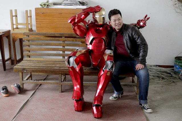 Cheng Chen (R), a 27-year-old worker at a state-owned enterprise, poses for a photograph with his nephew who is wearing his home-made Iron Man armour, in Xuzhou, Jiangsu province April 13, 2015. (Photo by Reuters/Stringer)