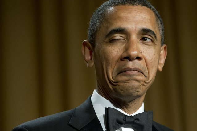 US President Barack Obama winks as he tells a joke about his place of birth during the White House Correspondents Association Dinner in Washington, DC, April 28, 2012. (Photo by Saul Loeb/AFP Photo)