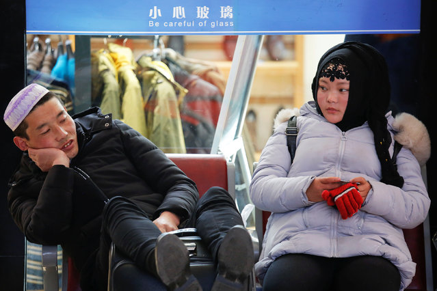 Passengers wait at the departure hall of the Beijing Railway Station in central Beijing, China January 27, 2017 as China gears up for Lunar New Year, when hundreds of millions of people head home. (Photo by Damir Sagolj/Reuters)