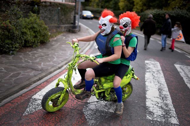 Masked revellers ride a motorbike during carnival celebrations in Ituren, northern Spain January 30, 2017. (Photo by Vincent West/Reuters)