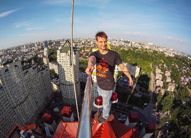 Yaroslav Segeda takes a selfie on top of a building. (Photo by Yaroslav Segeda/Solent News)