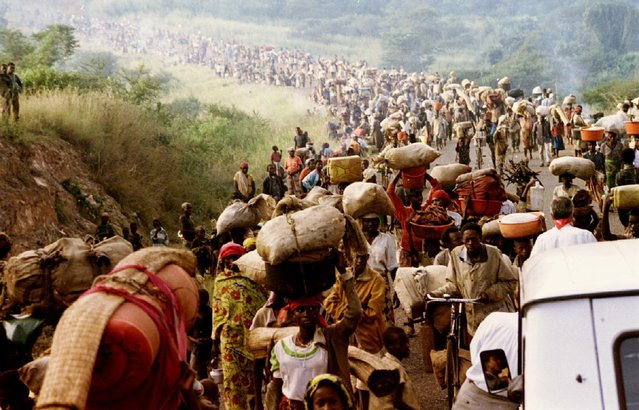 Rwandan refugees cross the Rusumo border to Tanzania from Rwanda carrying their belongings, goats, mattresses and cows, May 30, 1994. The bloodshed that claimed 800,000 Tutsi and moderate Hutu lives began 25 years ago on April 7, 1994, when a plane carrying Rwandan President Juvenal Habyarimana, Burundi President Cyprien Ntaryamira and a French air crew was shot down. (Photo by Jeremiah Kamau/Reuters)