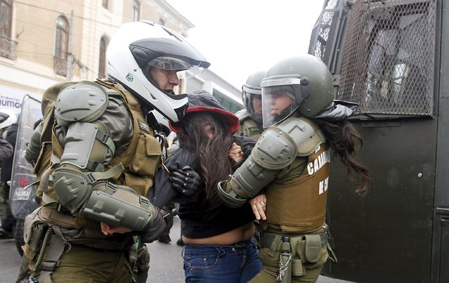 A student is detained by riot police during a protest against the government to demand changes and end to the profiteering in the education system, in Valparaiso,  May 14, 2015. (Photo by Rodrigo Garrido/Reuters)