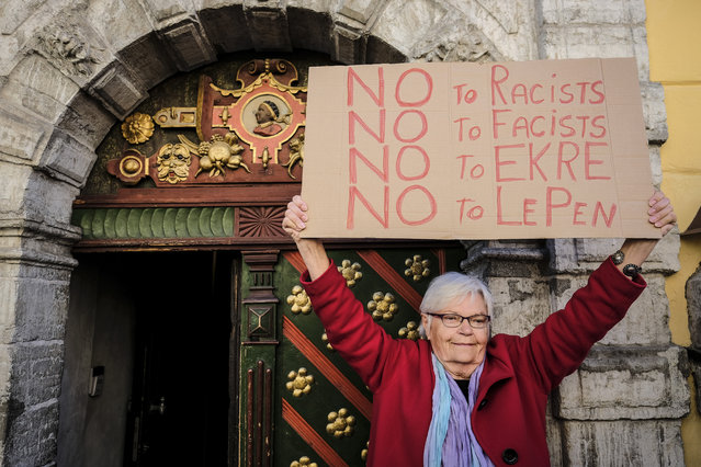 An activist protests against a meeting of Leader of the French National Front Marine Le Pen with Jaak Madison, member of Conservative People's Party of Estonia, Finns Party representative Olli Kotro, Danish People's Party representative Anders Vistisen, and Manuel Vescovi of Italy's Lega Nord at the House of the Blackheads in Tallinn, Estonia on Tuesday, May 14, 2019. (Photo by Hendrik Osula/AP Photo)