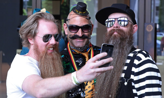 People take part in the international World Beard and Moustache Championships in Antwerp, Belgium May 18, 2019. (Photo by Yves Herman/Reuters)
