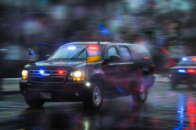 The motorcade carrying Ukrainian Prime Minister Arseniy Yatsenyuk leaves the White House after meeting with President Barack Obama. March, 12, 2014 in Washington, DC. (Photo by Craig Hudson/For The Washington Post)