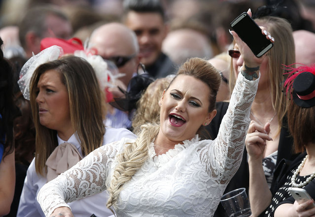 Racegoers watch the racing at the Grand National Festival on Ladies Day of the Crabbie's Grand National Festival at Aintree Racecourse on April 8, 2016 in Liverpool, England. (Photo by Andrew Boyers/Reuters/Livepic)