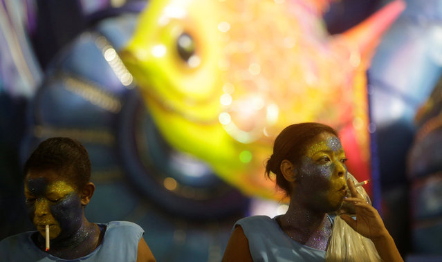 Revellers get ready before the second night of the Carnival parade of samba schools at the Sambadrome in Rio de Janeiro, Brazil, February 27, 2017. (Photo by Ricardo Moraes/Reuters)