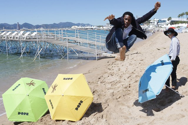 Shameik Moore jumps during a photo call for the film Dope, at the 68th international film festival, Cannes, southern France, Friday, May 22, 2015. (Photo by Joel Ryan/Invision/AP Photo)