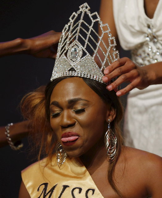 Newly crowned Miss Gay Jozi, Ycer Machimane, reacts at the pageant in Johannesburg, May 24, 2015. (Photo by Siphiwe Sibeko/Reuters)