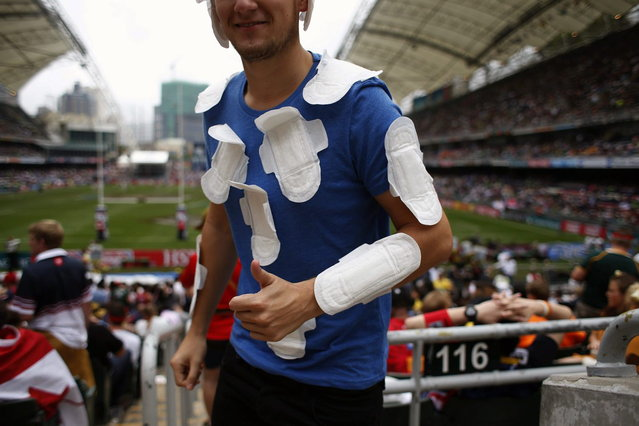 A rugby fan walks in the south stand on the last day of the three-day Hong Kong Sevens rugby tournament as part of the Sevens World Series in Hong Kong March 30, 2014. (Photo by Bobby Yip/Reuters)