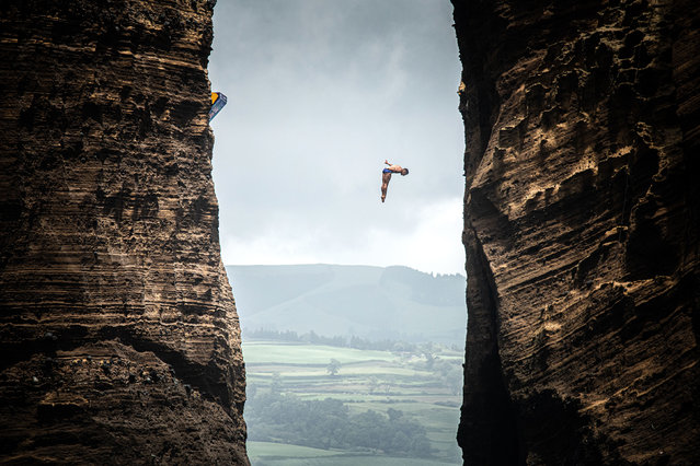 In this handout image provided by Red Bull, Jonathan Paredes of Mexico dives from the 27 metre platform at Islet Vila Franca do Campo during the final competition day of the fourth stop of the Red Bull Cliff Diving World Series on June 22, 2019 at Sao Miguel, Azores, Portugal. (Photo by Romina Amato/Red Bull via Getty Images)