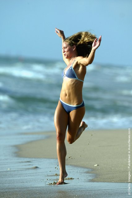 Girl dances on the sand on Fort Lauderdale Beach
